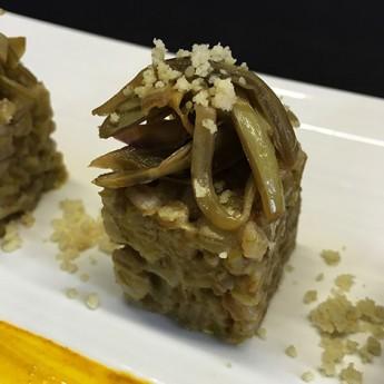 ricetta Farrotto scarola, carciofi e mandorle con pennellata di curcuma