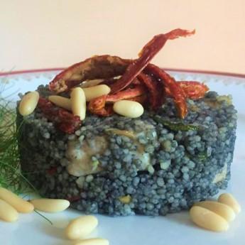 ricetta Cous cous al nero di seppia, pesce spada e pomodori secchi
